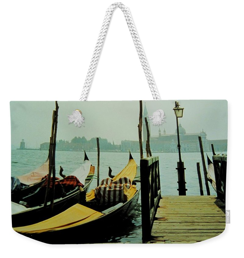 Venice Weekender Tote Bag featuring the photograph Gondolas by Ian MacDonald