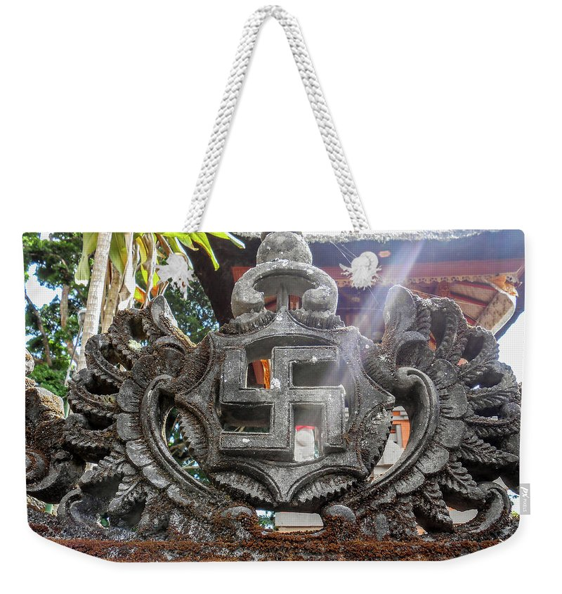 Swastika Weekender Tote Bag featuring the photograph Good Fortune by Julia Raddatz