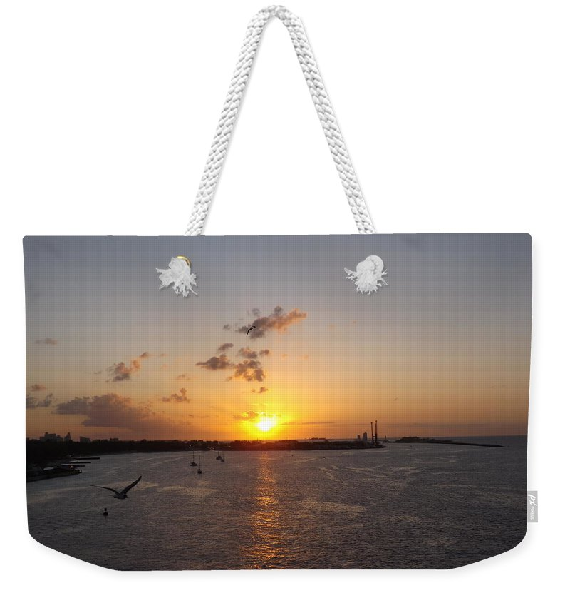 Sunset Weekender Tote Bag featuring the photograph Goodby Sunset by Jacqueline Whitcomb