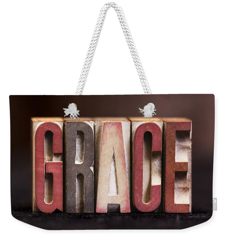 Pray Weekender Tote Bag featuring the photograph Grace - Antique Letterpress Letters by Donald Erickson