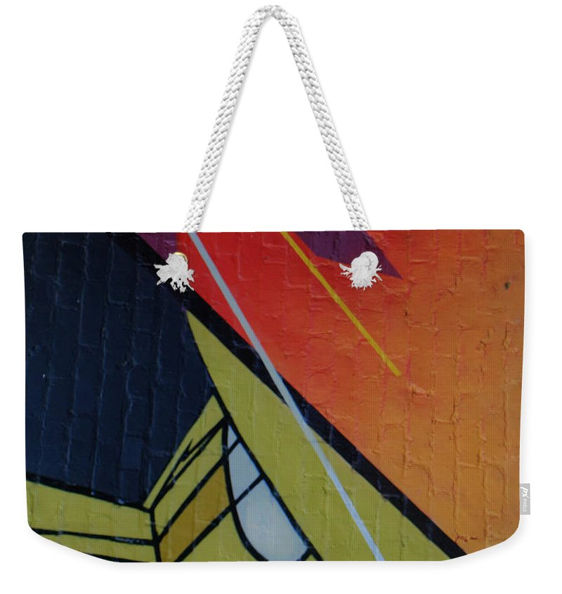 Abstract Weekender Tote Bag featuring the photograph Graffiti Wall by Dorothy Hilde
