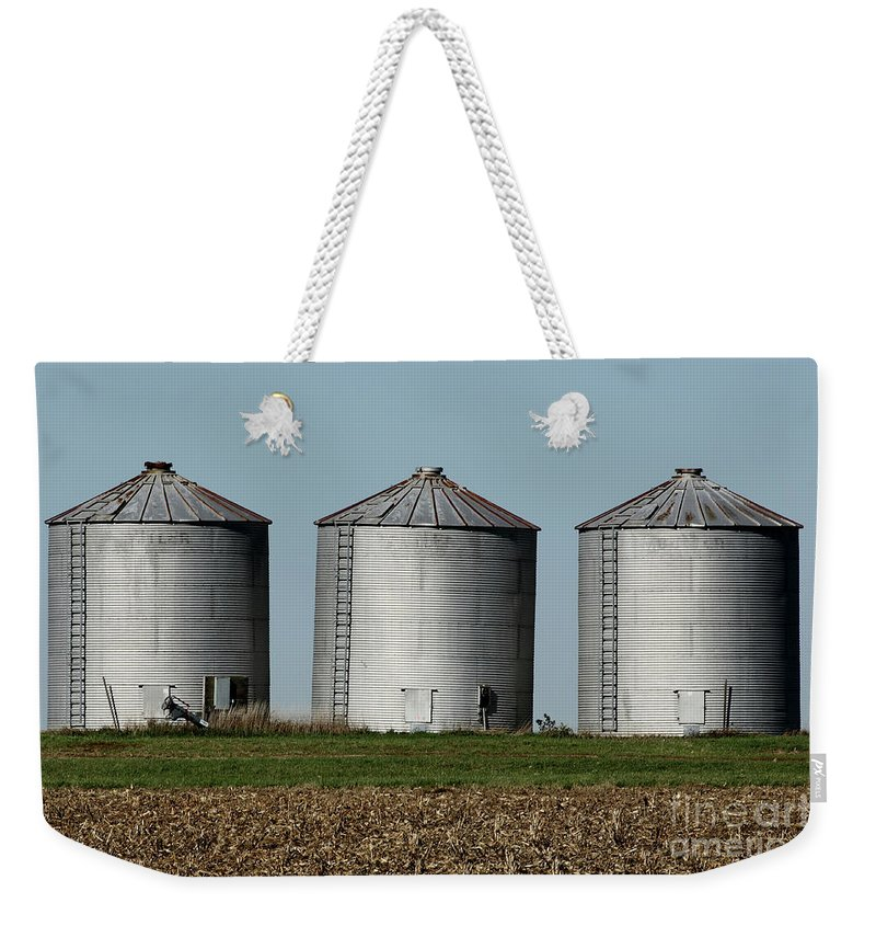 Agriculture Weekender Tote Bag featuring the photograph Grain Bins In A Row by Alan Look