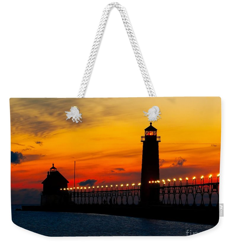 Architecture Weekender Tote Bag featuring the photograph Grand Haven Sunset by Nick Zelinsky