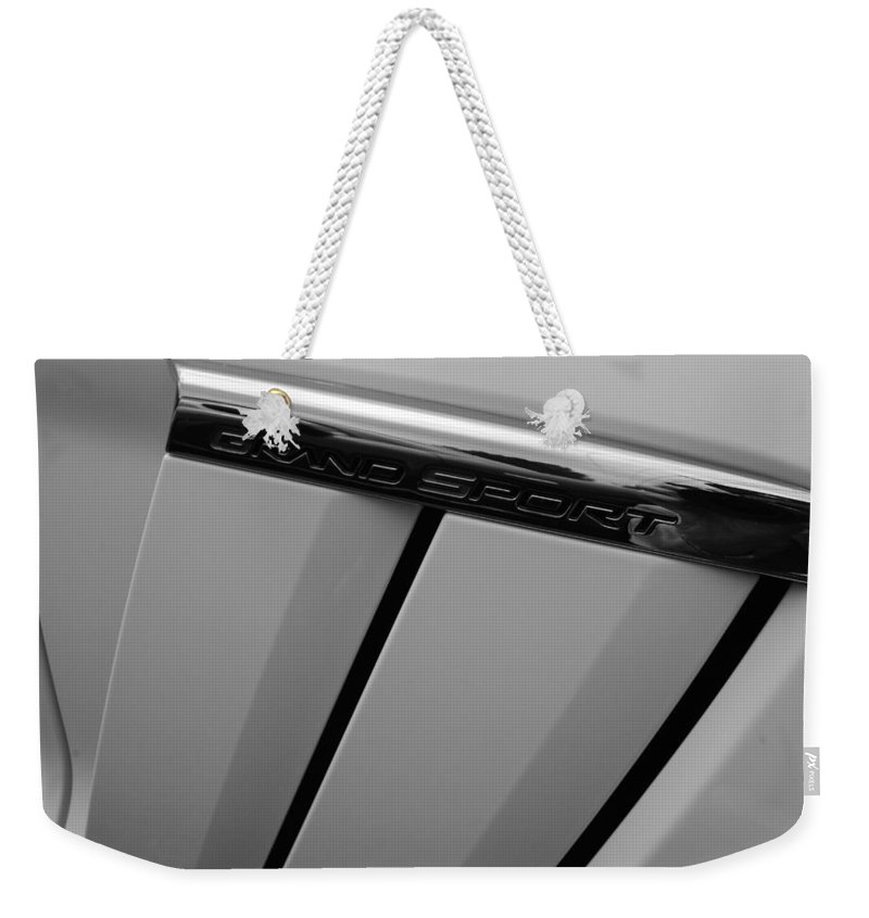 Automobiles Weekender Tote Bag featuring the photograph Grand Sport Badge by John Schneider