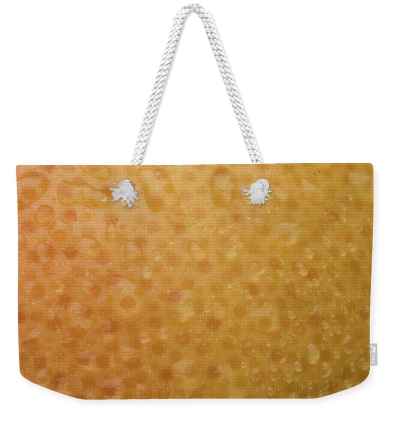 Grapefruit Weekender Tote Bag featuring the photograph Grapefruit Skin by Steve Gadomski