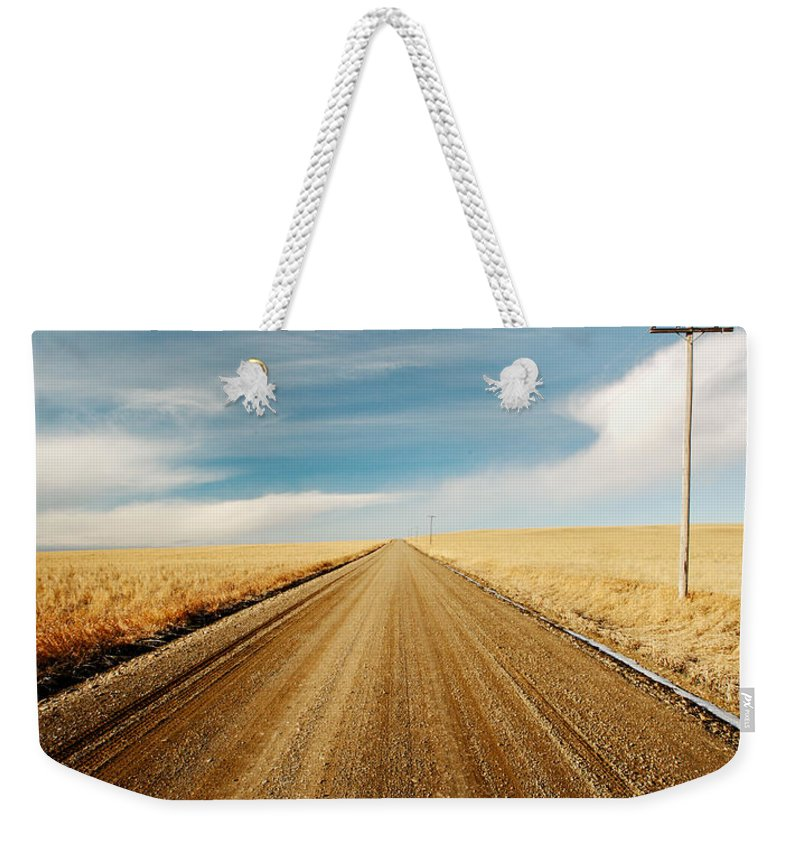 Landscape Weekender Tote Bag featuring the photograph Gravel Lines by Todd Klassy