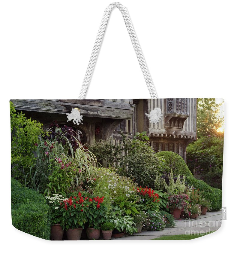 Sunset Weekender Tote Bag featuring the photograph Great Dixter House And Gardens At Sunset 2 by Perry Rodriguez