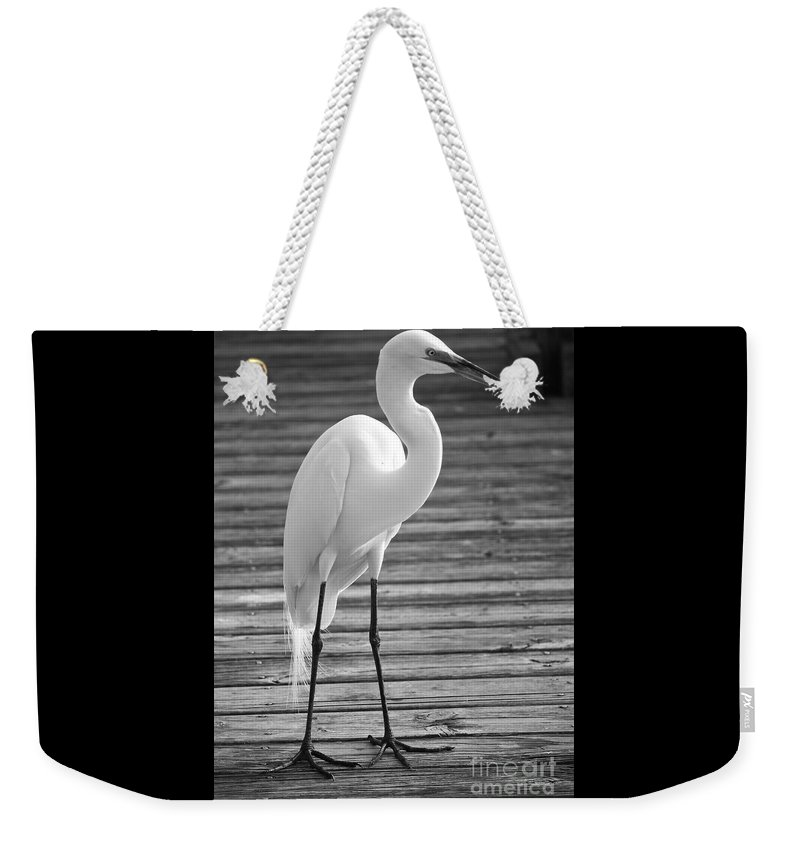 Egret Weekender Tote Bag featuring the photograph Great Egret On The Pier - Black And White by Carol Groenen