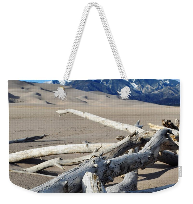 Great Sand Dunes National Park Weekender Tote Bag featuring the photograph Great Sand Dunes National Park Driftwood Portrait by Kyle Hanson