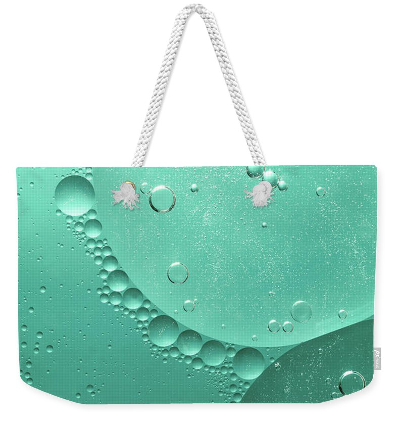 Abstract Weekender Tote Bag featuring the photograph Green Abstract Of Oil Droplet. by Jaroslav Frank
