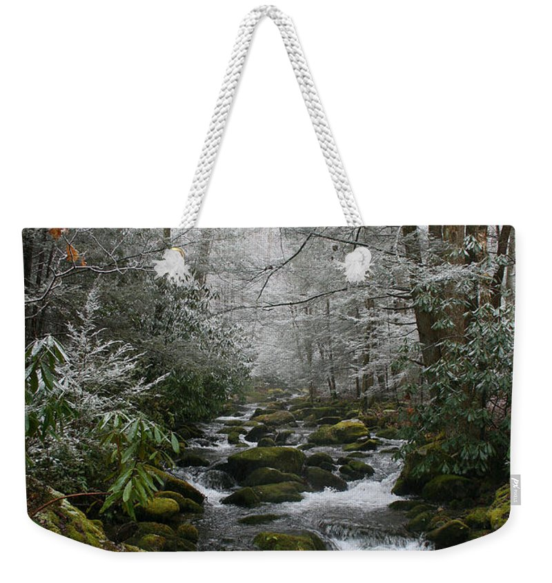 Green Snow Tree Trees Winter Stream River Creek Water Stone Rock Flow Boulder Forest Woods Cold Weekender Tote Bag featuring the photograph Green And White by Andrei Shliakhau