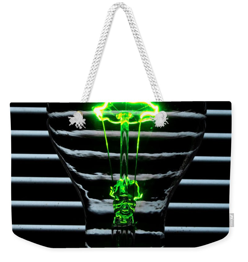 Green Weekender Tote Bag featuring the photograph Green Bulb by Rob Hawkins