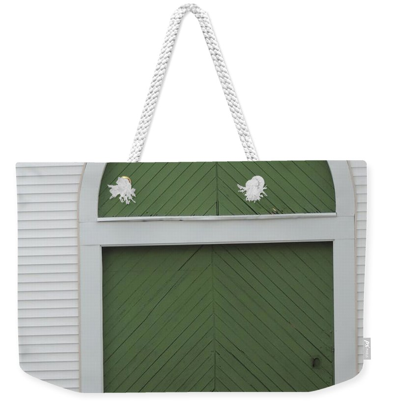 Photograph Weekender Tote Bag featuring the photograph Green Door Arch by Bill Tomsa