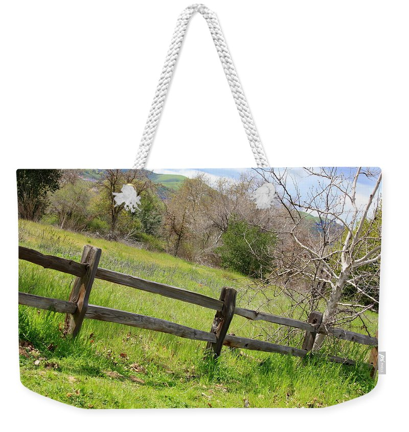 Landscape Weekender Tote Bag featuring the photograph Green Hills And Rustic Fence by Carol Groenen