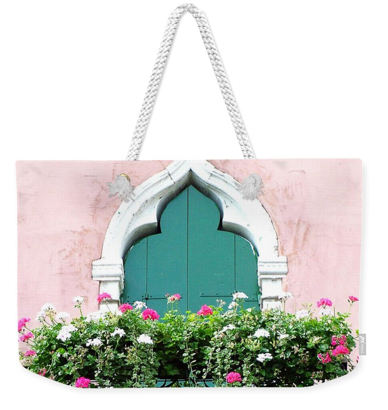 Green Weekender Tote Bag featuring the photograph Green Ornate Door With Geraniums by Donna Corless