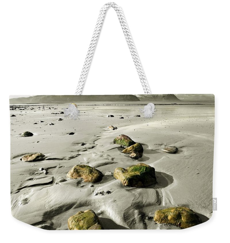Beach Weekender Tote Bag featuring the photograph Green Stones On A North Wales Beach by Mal Bray
