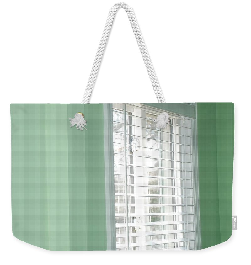 Architecture Weekender Tote Bag featuring the photograph Green Wall White Window by Rob Hans