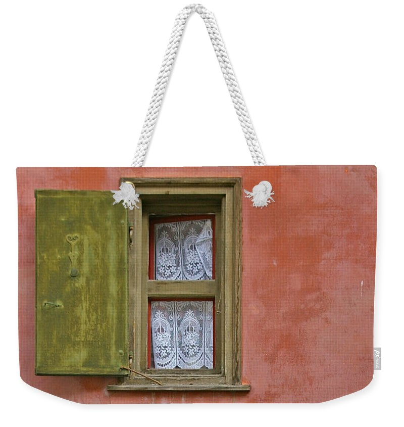 Red Weekender Tote Bag featuring the photograph Green Window On A Red Wall by Tom Reynen