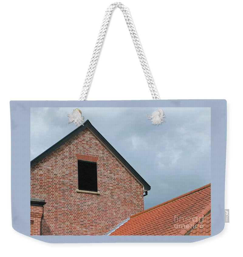 Brick Weekender Tote Bag featuring the photograph Grey Skyline by Ann Horn