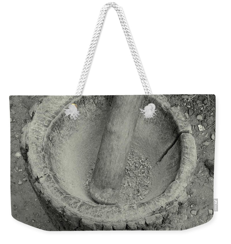 Corn Weekender Tote Bag featuring the photograph Grinding Corn by Peg Urban
