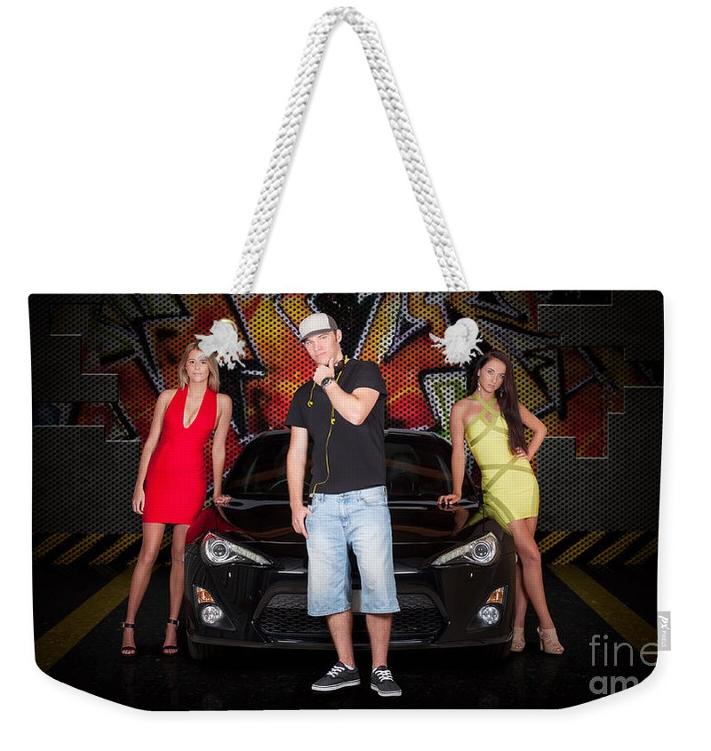 People Weekender Tote Bag featuring the photograph Group Of Young People Beside Black Modern Car by Jorgo Photography - Wall Art Gallery