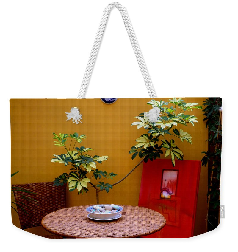 Artists Studio Weekender Tote Bag featuring the photograph Guess Who's Coming To Dinner by Charles Stuart