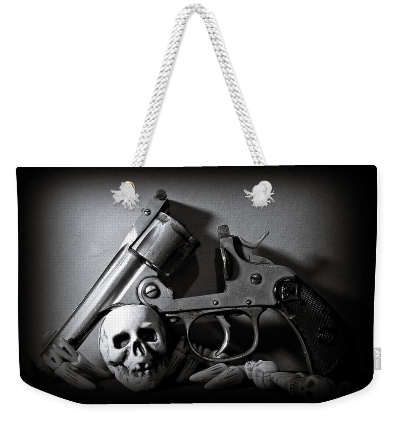 Black And White Weekender Tote Bag featuring the photograph Gun And Skull by Scott Wyatt
