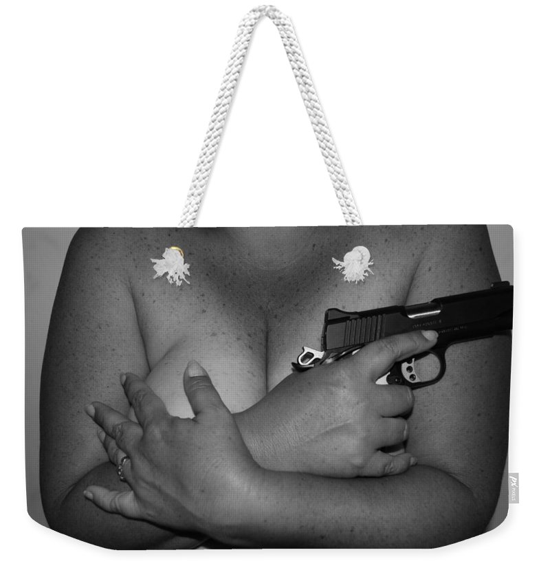 Black And White Weekender Tote Bag featuring the photograph Guns And Ammo by Rob Hans