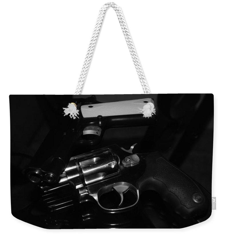 Guns Weekender Tote Bag featuring the photograph Guns And More Guns by Rob Hans
