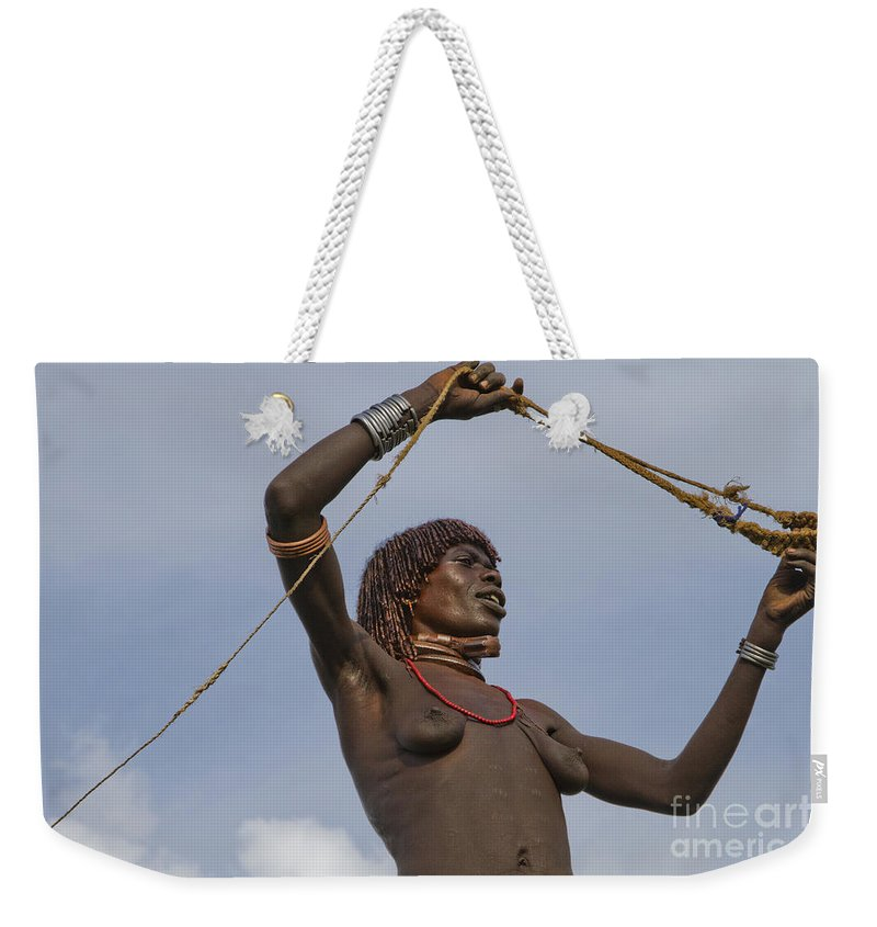 Slingshot Weekender Tote Bag featuring the photograph Hamer Tribe Woman, Ethiopia by Eyal Bartov