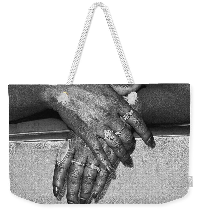 Hands Weekender Tote Bag featuring the photograph Hands by Herman Robert
