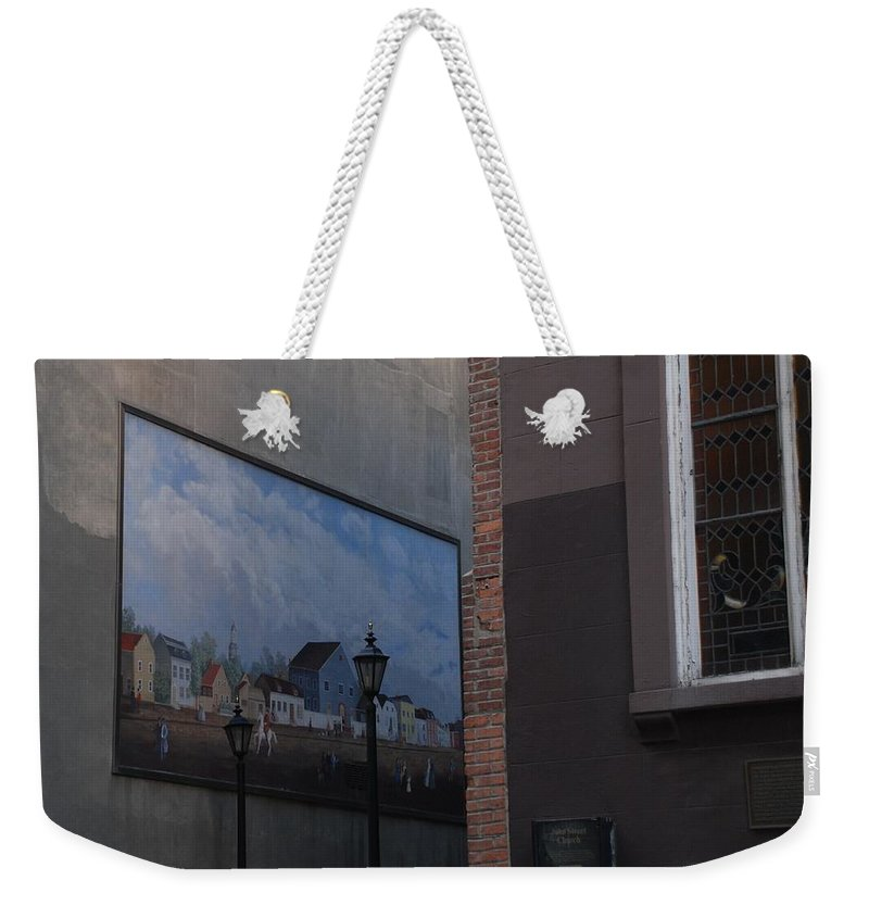 Street Scene Weekender Tote Bag featuring the photograph Hanging Art In N Y C by Rob Hans