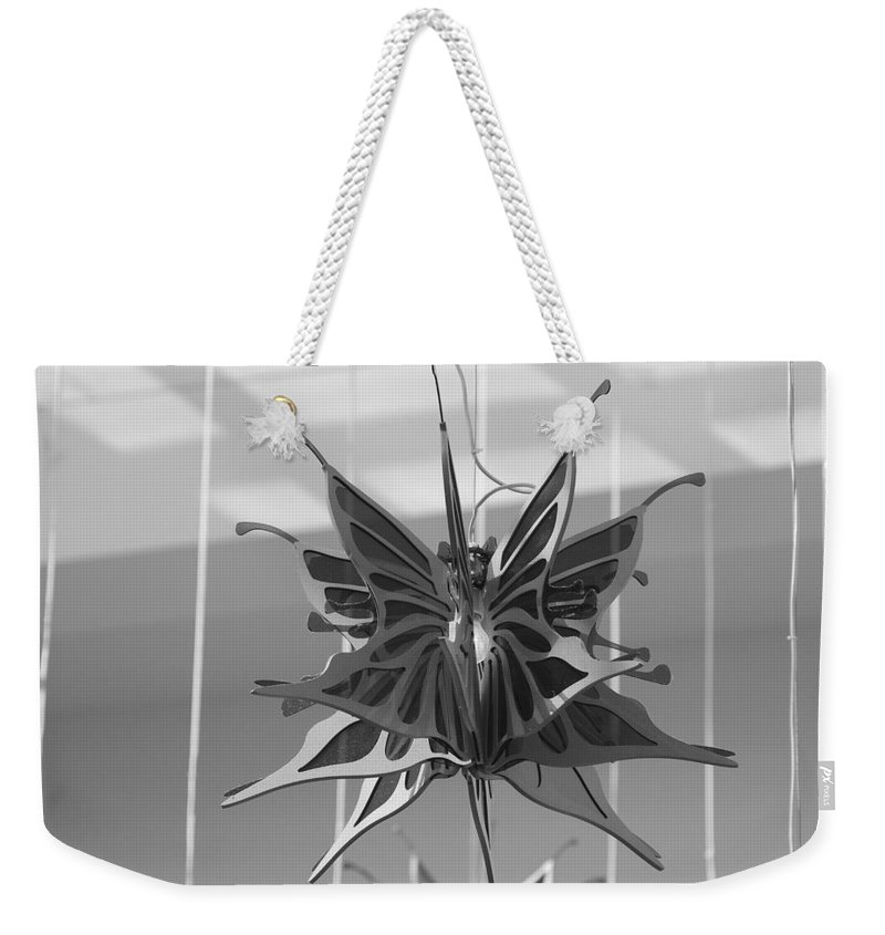 Black And White Weekender Tote Bag featuring the photograph Hanging Butterfly by Rob Hans