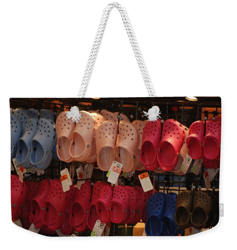 Pop Art Weekender Tote Bag featuring the photograph Hanging Crocs by Rob Hans