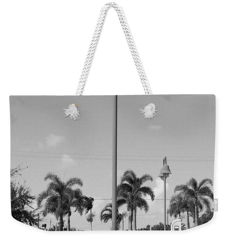 Black And White Weekender Tote Bag featuring the photograph Hanging Lamps by Rob Hans
