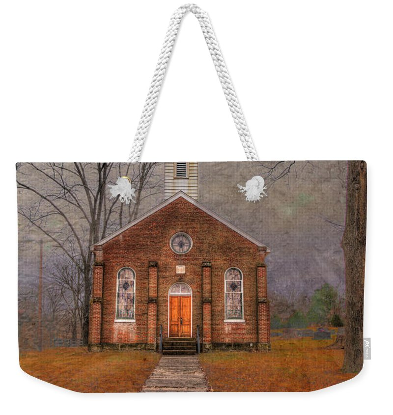 Travel Weekender Tote Bag featuring the photograph Hanover Luthern Chruch by Larry Braun