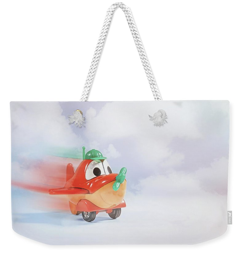 Toy Weekender Tote Bag featuring the photograph Happy Flying by Scott Norris