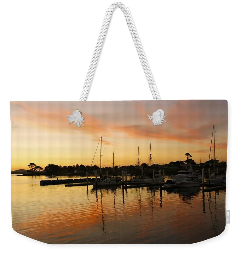 Sunset Weekender Tote Bag featuring the photograph Harbour Sun Set by Kathryn Potempski
