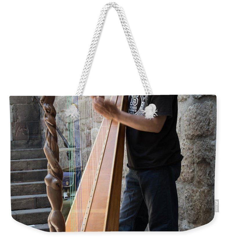 Street Weekender Tote Bag featuring the photograph Harpist Street Musician, Barcelona, Spain by Nicole Freedman