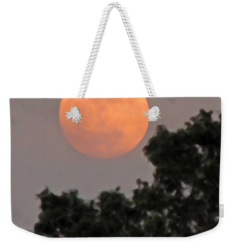 Moon Weekender Tote Bag featuring the photograph Harvest Moonrise by Peg Urban