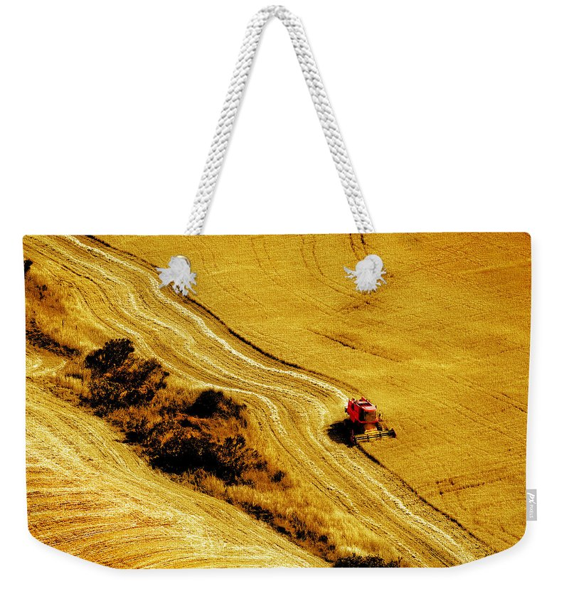 Combine Weekender Tote Bag featuring the photograph Harvesting The Crop by Mal Bray