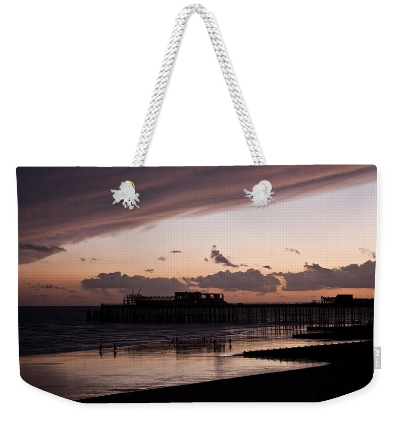 Hastings Pier Weekender Tote Bag featuring the photograph Hastings Pier by Dawn OConnor