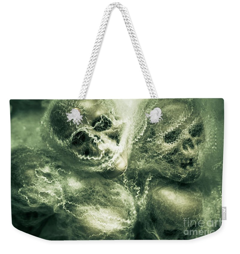 Haunted Weekender Tote Bag featuring the photograph Haunted Undead Skeleton Heads by Jorgo Photography - Wall Art Gallery