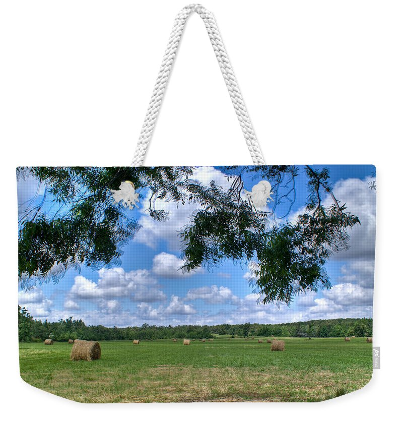 Hay Weekender Tote Bag featuring the photograph Hay Field In Summertime by Douglas Barnett