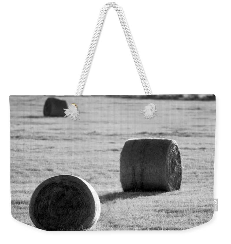 Black And White Weekender Tote Bag featuring the photograph Hay Is For Horses by Jill Reger