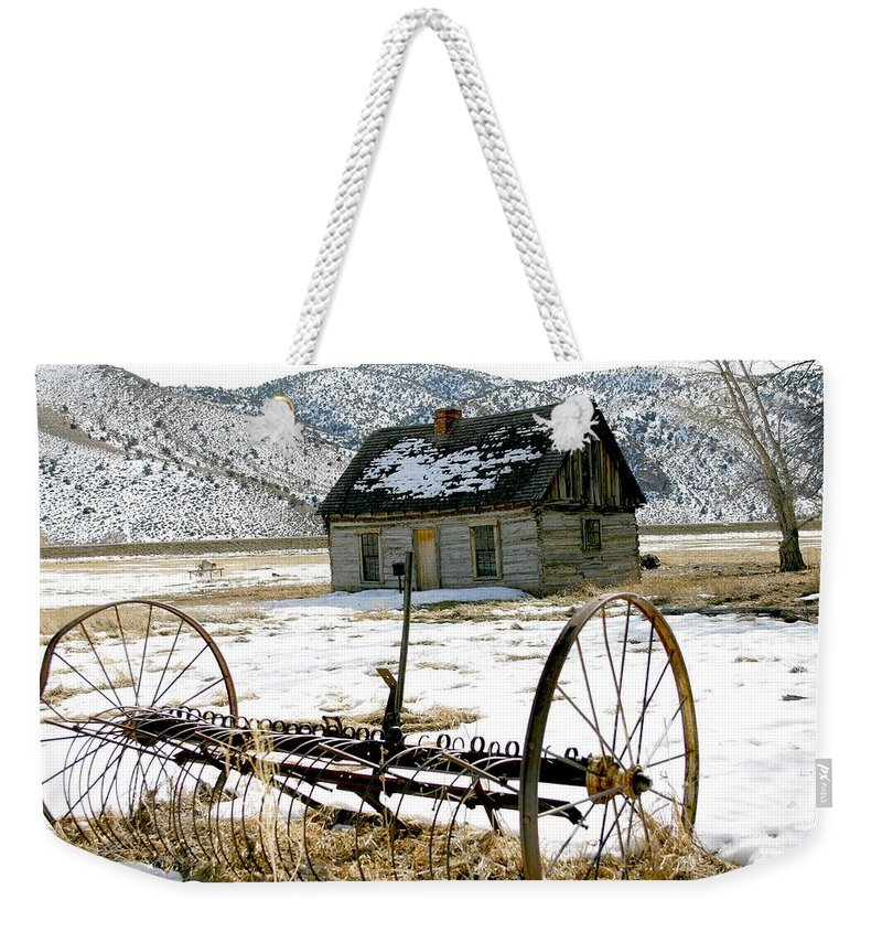 Utah Weekender Tote Bag featuring the photograph Hay Rake At Butch Cassidy by Nelson Strong