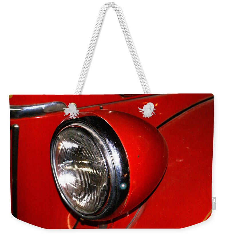 Headlamp Weekender Tote Bag featuring the photograph Headlamp On Antique Fire Engine by Douglas Barnett