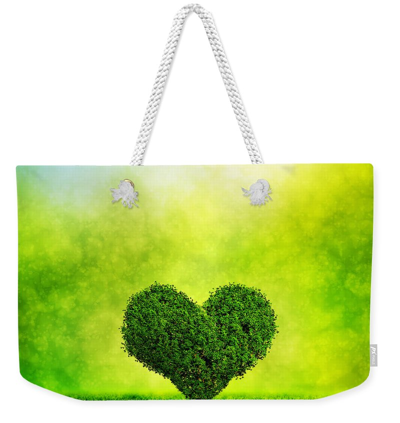 Love Weekender Tote Bag featuring the photograph Heart Shaped Tree Growing On Green Grass by Michal Bednarek
