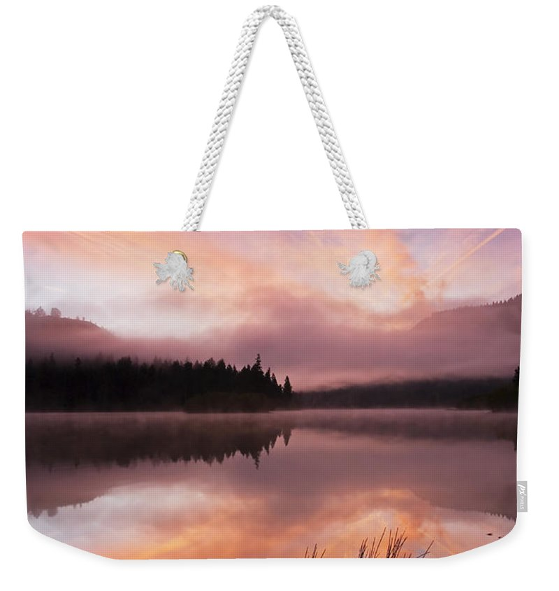 Sunrise Weekender Tote Bag featuring the photograph Heavenly Skies by Mike Dawson
