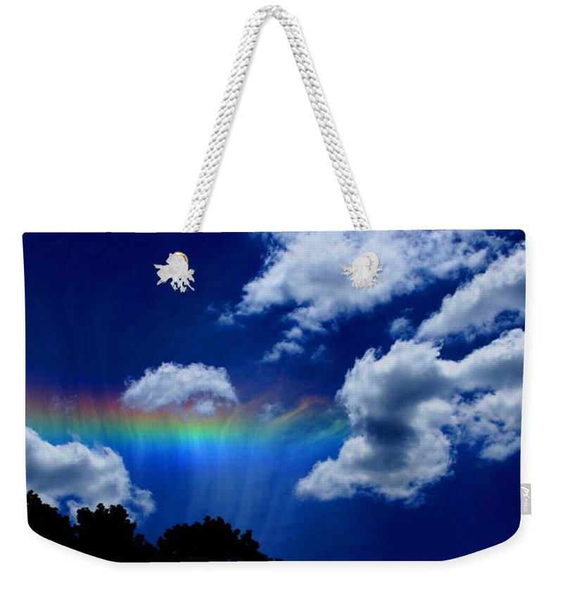 Heavens Rainbow Weekender Tote Bag featuring the photograph Heavens Rainbow by Linda Sannuti